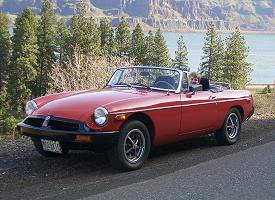 Click to see full size pic of Pat sitting is his MGB, waiting for his 16th birthday